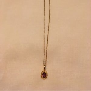 Jewelry - Gold tone chain with faux gemstone pendant